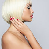 Fashionable young woman. Fashionable young blond woman with beautiful makeup Stock Image
