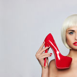Fashionable young woman. Fashionable young blonde and red shoes Royalty Free Stock Image