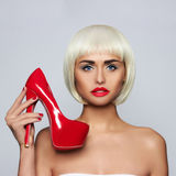 Fashionable young woman. Fashionable young blonde and red shoes Royalty Free Stock Images