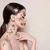 Fashionable young woman. Fashion model with a bright and beautiful makeup Royalty Free Stock Images
