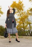 Fashionable young woman with hand bag Royalty Free Stock Photos