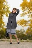 Fashionable young woman with hand bag Stock Photo