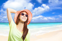Fashionable young woman have a vacation in the beach Stock Photography