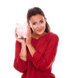 Fashionable young woman with her piggybank Stock Images