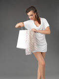 Fashionable Young Woman Holding A Shoppping Bag Stock Image