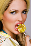 Fashionable young woman holding a candy Stock Image