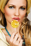 Fashionable young woman holding a candy Royalty Free Stock Photo