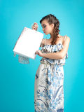Fashionable young woman holding a shopping bag Royalty Free Stock Photo