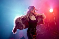 Free Fashionable Young Woman In A Fluffy Pink Coat, Neon Light. Stylish Trending Girl Dancing At The Party. Stock Images - 112482014