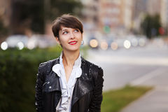 Fashionable young woman in leather jacket Stock Images