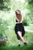 Fashionable young woman outdoors Royalty Free Stock Photos