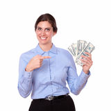 Fashionable young woman pointing to money Royalty Free Stock Images
