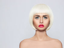 Fashionable young woman. Portrait which shows a bright blonde with perfect makeup Stock Photography