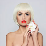Fashionable young woman. Portrait which shows a bright blonde with perfect makeup Royalty Free Stock Photo