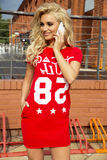 Fashionable young woman posing. Fashionable young blonde woman posing outdoor. Girl with long curly hair royalty free stock photography
