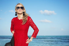 Fashionable young woman in red dress Stock Photography