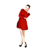 Fashionable young woman in red dress Royalty Free Stock Photography