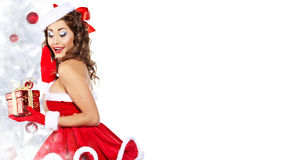Fashionable young woman in Santa Claus clothes Stock Images