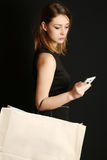 Fashionable young woman with shopping bag Royalty Free Stock Image