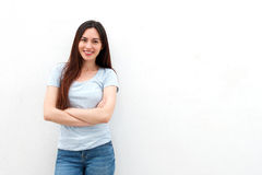 Fashionable young woman smiling with arms crossed. Portrait of fashionable young woman smiling with arms crossed stock photography