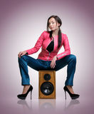 Fashionable young woman on the speaker Stock Images
