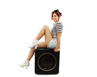 Fashionable young woman on the speaker Royalty Free Stock Photos