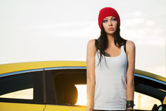 Young fashion punk woman standing next to car Stock Image