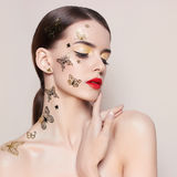 Fashionable young woman. With stunning makeup Stock Photography