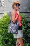 Fashionable young woman with stylish snakeskin python handbag, accessories, sunglasses, summer day, tropical Bali island Stock Photo