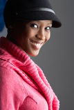 Fashionable Young Woman Wearing Cap And Knitwear. In Studio stock photo