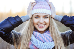Fashionable young woman wearing hat and scarf Royalty Free Stock Photography
