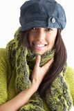 Fashionable Young Woman Wearing Knitwear In Studio. Fashionable Young Woman Wearing Cap And Knitwear In Studio royalty free stock image