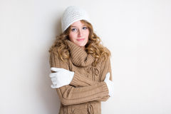 Fashionable young woman in winter outfit. Royalty Free Stock Image