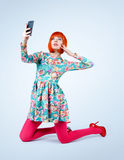 Fashionable young women in dress with smart phone. Make selfie Royalty Free Stock Photos
