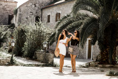 Fashionable young women posing on the street in summer Royalty Free Stock Photography