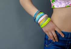 Fashionable youth braided bracelets on her arm girl Stock Photos