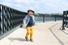 Fashionably dressed cute little boy in straw hat walks in summer Royalty Free Stock Images