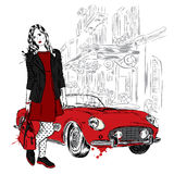 Fashionably dressed girl on the background of a city street and car. Vector illustration for greeting card, poster, or print on cl Royalty Free Stock Image