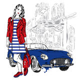 Fashionably dressed girl on the background of a city street and car. Vector illustration for greeting card, poster, or print on cl Royalty Free Stock Photography