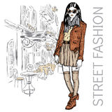 Fashionably dressed girl on the background of a city street. Vector illustration for greeting card, poster, or print on clothes. F Stock Image