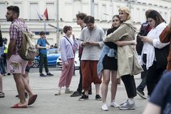 Fashionably dressed girls hugging in the park. Moscow, RUSSIA - June 12, 2019: Fashionably dressed girls hugging in the park stock image