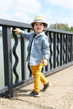 Fashionably dressed little child walks in summer Stock Image