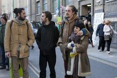 Fashionably dressed people listening to street musicians on Brick Lane Stock Image