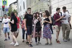 Fashionably dressed people walk downtown. Moscow, RUSSIA - June 12, 2019: Fashionably dressed people walk downtown stock image