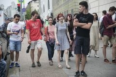 Fashionably dressed people walk downtown. Moscow, RUSSIA - June 12, 2019: Fashionably dressed people walk downtown royalty free stock photography