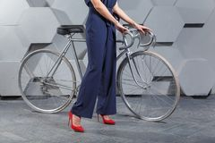 Fashionably dressed woman with bike royalty free stock images