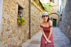 Fashionably dressed woman on the streets of a small Italian town.  Stock Photography