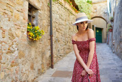 Fashionably dressed woman on the streets of a small Italian town.  Stock Photo