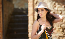 Fashionably dressed woman on the streets of a small Italian town.  Royalty Free Stock Photos
