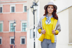 Fashionably dressed woman on the streets stock image